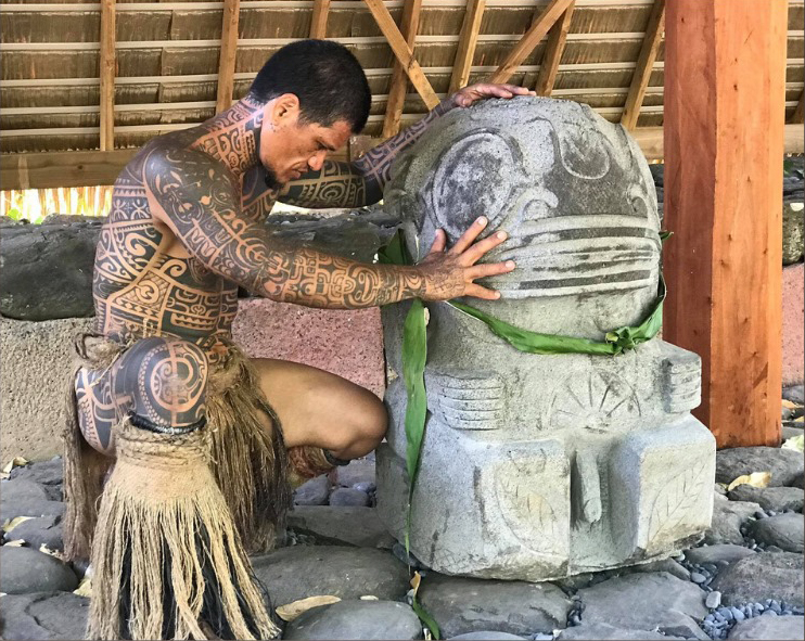 Marquisan Man praying on a stone Tiki