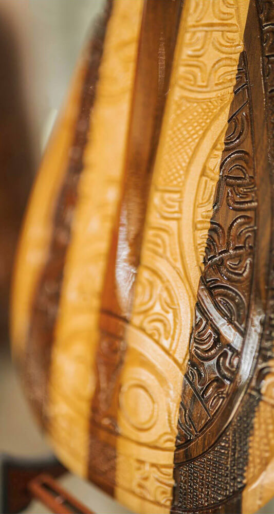 Focus on a engraved Polynesian Paddle